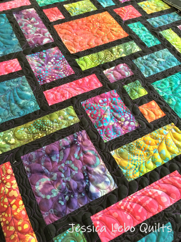 stained glass batik quilt feather freemotion quilting